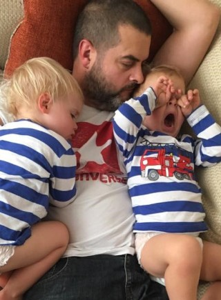 Dad sleeping with babies